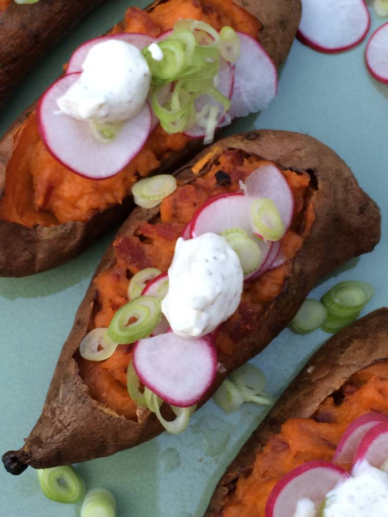 Baked Sweet Potato with bacon, radishes and spring onions